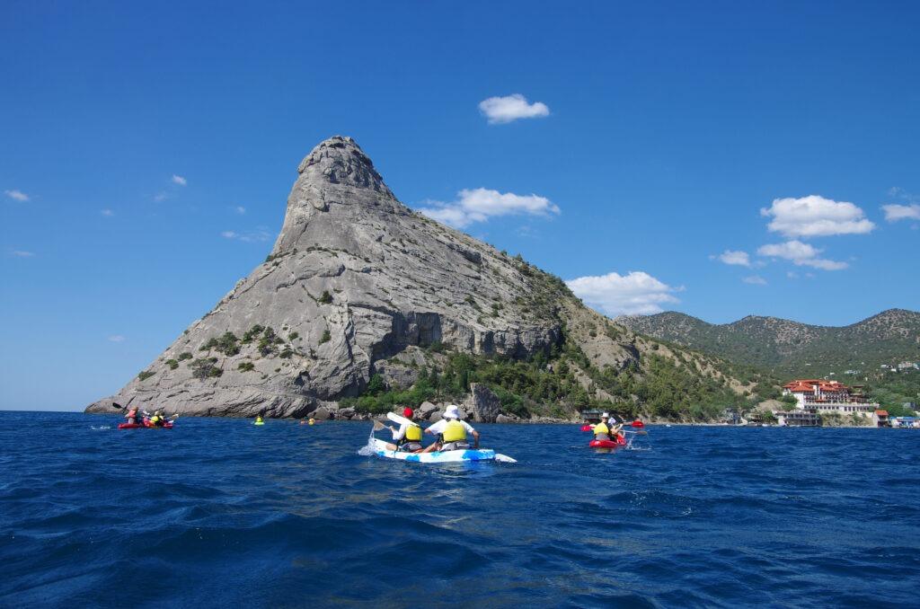 SUDAK, CRIMEA - July, 2020: Kayaking on the Black sea along the coast